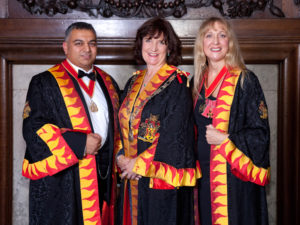 New Master Fueller Chloe Andrews-Jones with Senior Warden Shravan Joshi and Junior Warden Averil Macdonald